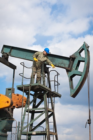 worker in the oil industry on oil pump Stock Photo - 13253288