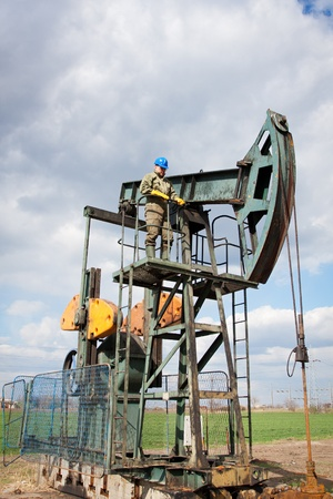 worker in the oil industry on oil pump photo