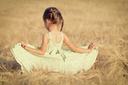 Happy girl in the field of wheat on sunny day Stock Photo - 13991619