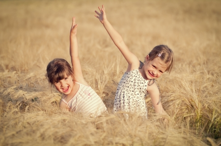 Happy girl in the field of wheat on sunny day Stock Photo - 13991621
