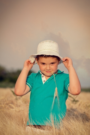 Little boy in wheat field Stock Photo - 14122317