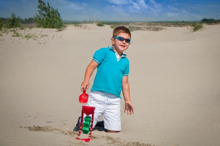 boy playing with beach toys photo