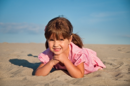 little girl on beach photo