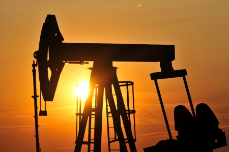 oil well: Oil Pump on orange sunset
