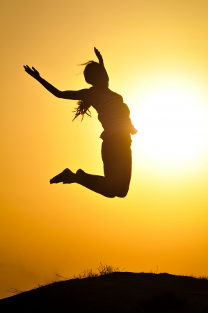 Girl jump in the sunset