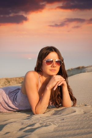 Girl lying on the sand Stock Photo - 14722712