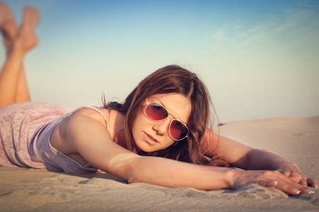 Girl lying on the sand Stock Photo - 14722706