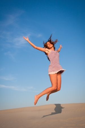 Young girl jumping in the sunset Stock Photo - 14722716