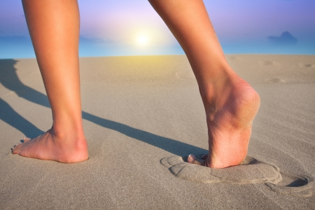 footprints sand: Walking on the sand