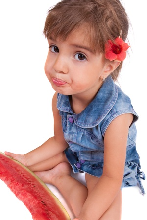Little smiling girl eating watermelon photo