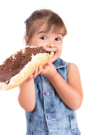 eats: beautiful little girl eats bread with chocolate cream Stock Photo
