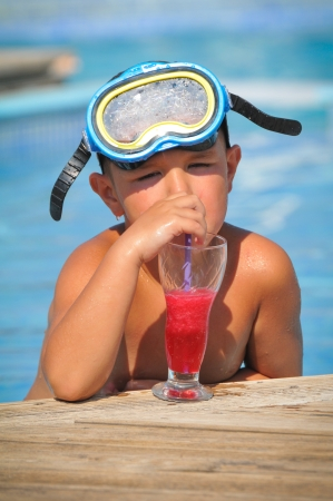 boy with dive mask drink cocktails photo
