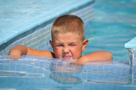 Boy in the pool photo
