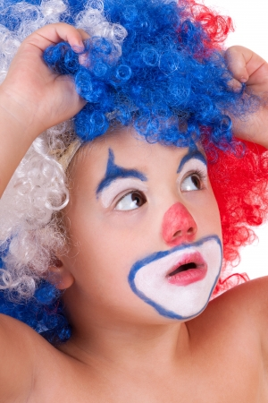 closeup image of the cute little clown boy photo