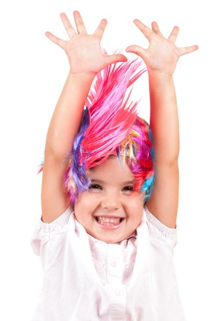 Little girl with colorful wigs photo