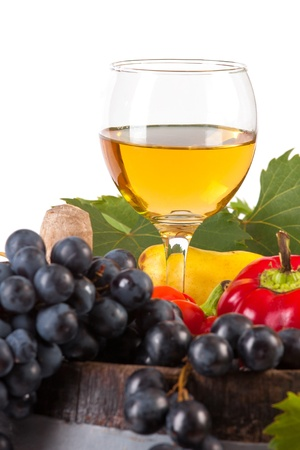 Glass of white wine and various autumn fruits photo