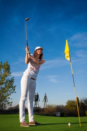 Woman playing golf Stock Photo - 15971565