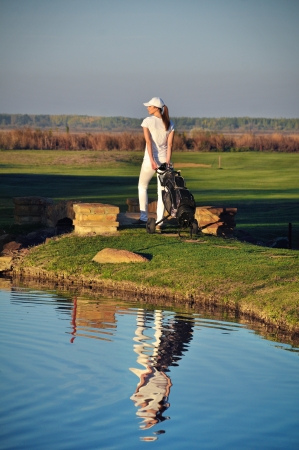 Woman playing golf photo