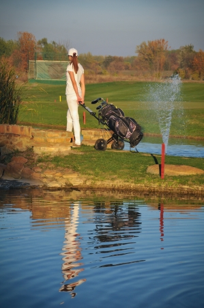 Woman playing golf Stock Photo - 16038875