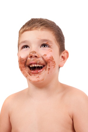 Cute kid with chocolate on his face photo