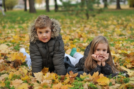 Kids playing in autumn park  photo