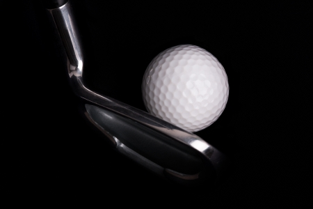 golf club with ball on black background  photo