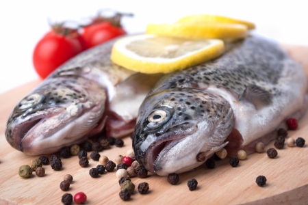 trout on a wooden board with spices Stock Photo - 18512997