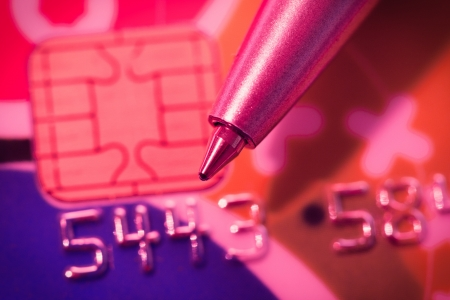 Credit card and pen close up color red light Stock Photo - 18707552