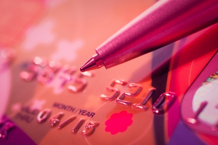 Credit card and pen close up color red light Stock Photo - 18707556
