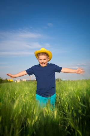 Boy in the wheat field photo