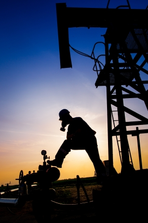 Oil worker silhouette photo