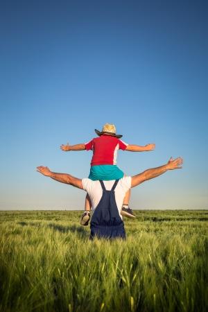 Farmer and the boy in the field Standard-Bild