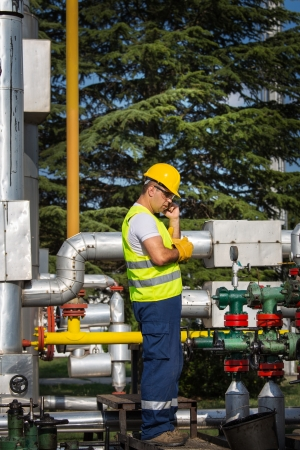 Gas Production Operator Maintains Well Site Stock Photo, Picture And ...