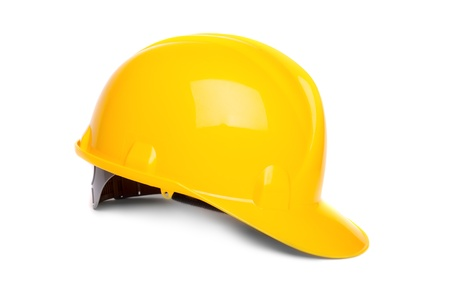 Yellow hard hat isolated on white photo