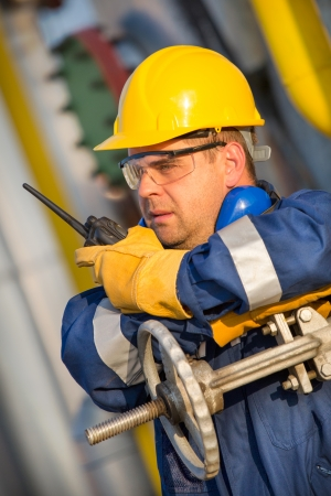 greenhouse gas: system operator in oil and gas production Stock Photo