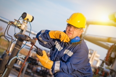 gas pipe: system operator in oil and gas production Stock Photo