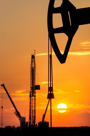 oil rig over orange sky photo
