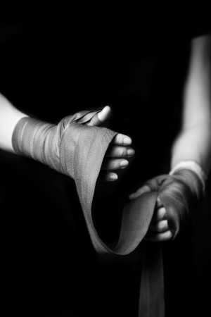 boxing training: Woman wrapping her hands