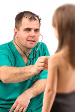 Doctor examining little girl in hospital