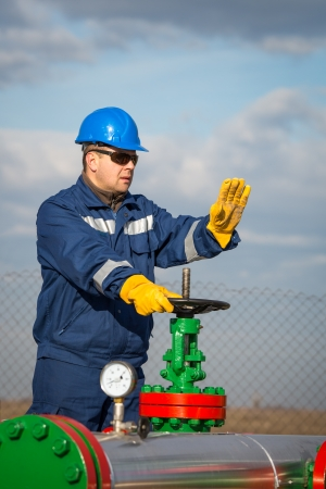 Oil worker turning valve photo