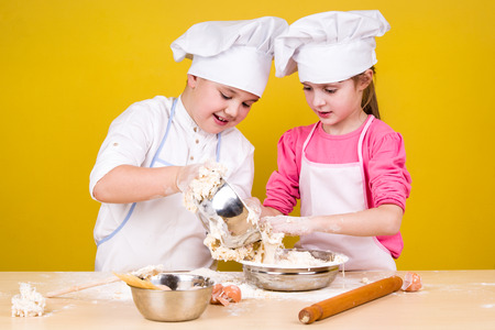 Cheerful children cook pizza photo