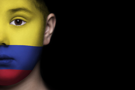 Human face painted with flag of Colombia 写真素材