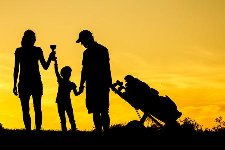 Golfer at sunset photo