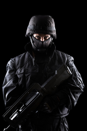 swat teams: Spec ops soldier on black background Stock Photo