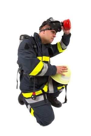 Fireman in uniform isolated in white photo