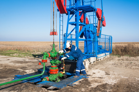 exhausted worker: Oil worker check oil pump