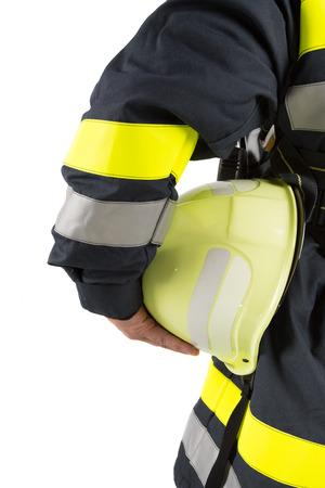 Firefighter bedrijf helm op wit wordt geïsoleerd Stockfoto