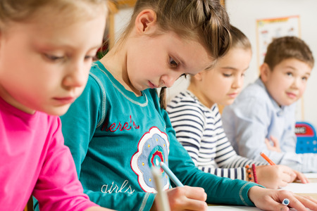 pupils: Junior pupils drawing with highlighters