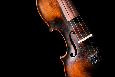 violin background: Vintage violin on black background