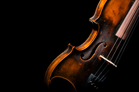 Vintage violin on black background